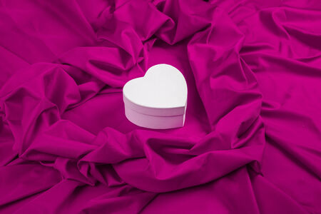 love card. white paper heart on a purple fabric photo