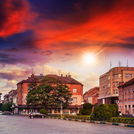 area of ​​the old city near the park wrapped by cobbled street at sunset