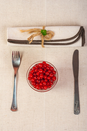 restaurant served red currants in a glass with green leaves