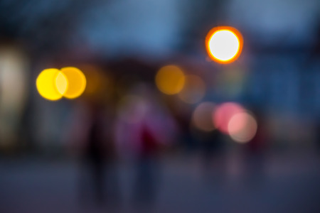 abstract background of blurred warm  and cool blue lights on city street  background with bokeh effect