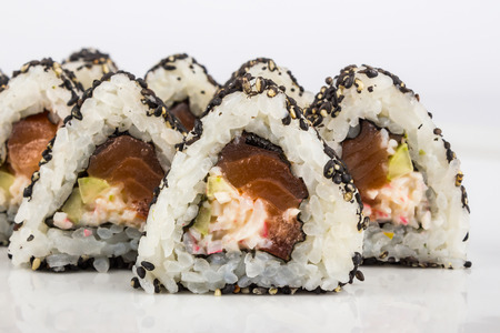 triangular sushi with cucumber sesame seeds