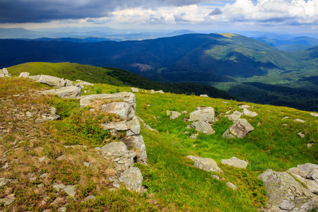 white sharp stones on the hillside in hight mountains Stock Photo - 29355994