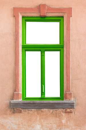green window frame on a pink old grunge wall
