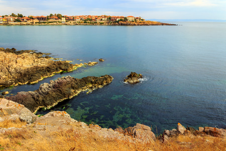 ancient european city on a rocky shore near sea in summer