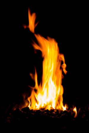 powerful high flame burning wood on black background in stoves