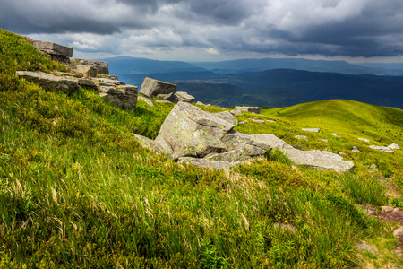 summer landscape with white sharp stones on the hillside meadow before the rain Stock Photo