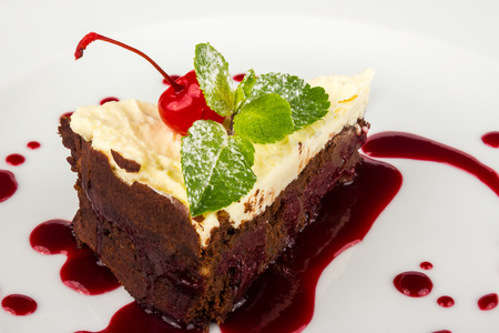 chocolate cake without flour with mascarpone cream and  cherry decorated with mint leaf Stock Photo
