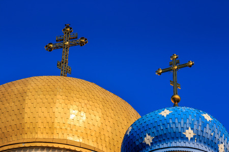 two domes of the Orthodox church with golden crosses