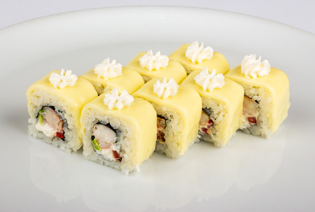 Sushi roll with crabs meat, pepper and avocado