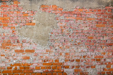 yellow brick wall one brick red Stock Photo