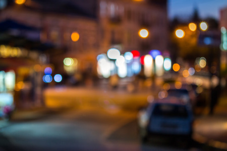 abstract blur of old city street with shops  at night