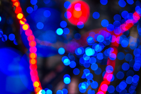 abstract background of blurred warm red  and cool blue lights with bokeh effect