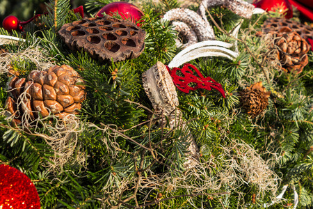 christmas background with toys, cake and fir-cones on fir tree branches with shallow depth of field