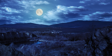 collage of small lake in an abandoned stone quarry in the mountains outside the city at night in full moon light