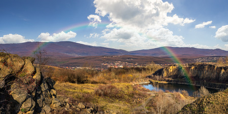 collage of small lake in an abandoned stone quarry in the mountains outside the city with rainbow in morning light