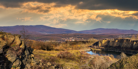 collage of small lake in an abandoned stone quarry in the mountains outside the city Stock Photo