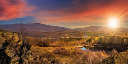 collage of small lake in an abandoned stone quarry in the mountains outside the city in sunset light Stock Photo