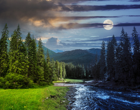 collage day and night landscape with pine trees in mountains and a river in front flowing to lake with full moon