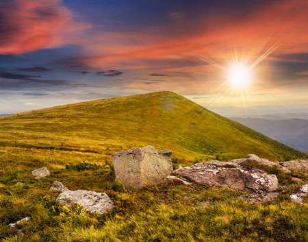 composit: composit landscape with white sharp boulders on the hillside near mountain peak in sunset light
