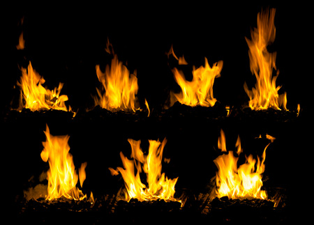 collage of powerful high flame burning wood on black background in stoves Stock Photo