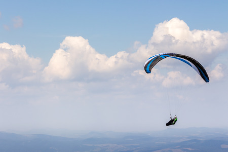Skydiving  flying over the mountains. parachute extreme sport Stock Photo - 37730588