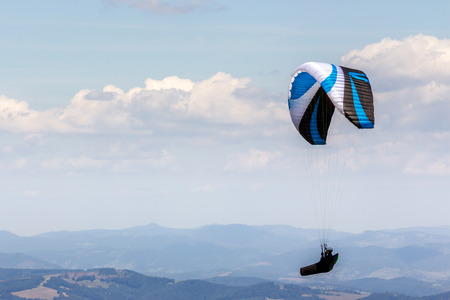 Skydiving  flying over the mountains. parachute extreme sport Stock Photo - 37730590