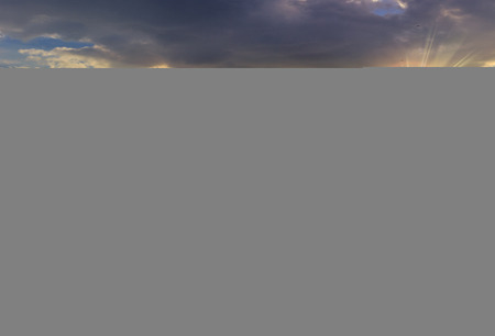 composit landscape with white sharp boulders on the hillside near mountain peak in evening light