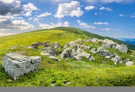 composit: composit landscape with white sharp boulders on the hillside near mountain peak Stock Photo