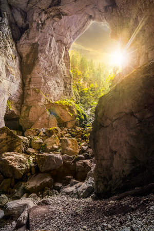 Cetatile cave in romania. Natural citadel sculpted by river in romanian mountains in evening light Stock Photo