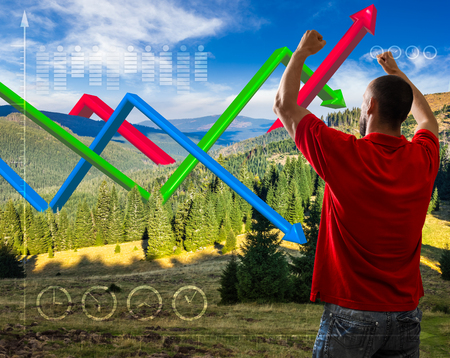 concept message to save environment. man looking on 3D graphs over mountain landscape with conifer forest