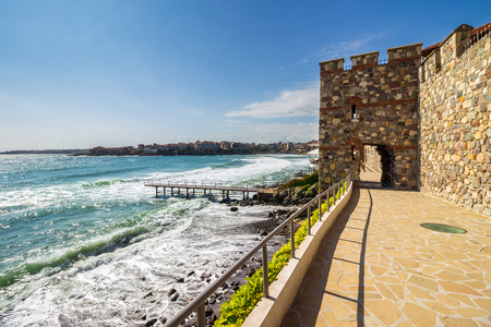 ancient european city Sozopol on a rocky shore near sea in summer. piere and steps to sea shore Stock Photo