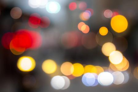defocused image light of city streetlights in autumn evening