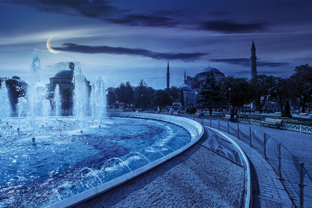 Fountain in park near Sophia basilica museum in Istanbul, Turkey on at night in full moon light
