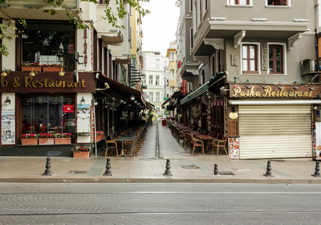 ISTANBUL - AUGUST 18: Divan Yolu street on August 18, 2015 in Istanbul. Turkish restaurants on Divan Yolu and  Bestekar Osman street near Sultanahmet Square  in Istanbul