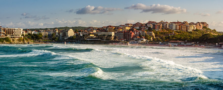 Evening waves before storm near the shore of ancient european resort town Sozopol in summer Stock Photo - 53077684