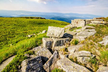 white sharp stones on the hillside on top of mountain range