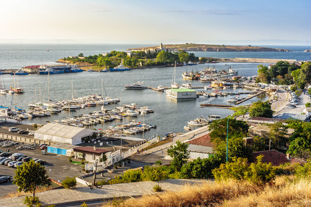 SOZOPOL - AUGUST 9: boats at sunset on August 9, 2015 in Sozopol, Bulgaria. boats and yachts docked near embankment in port of Bulgarian town Sozopol in evening light Stock Photo - 61168667
