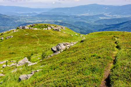 summer landscape. path through hill side among the rocks on mountain top Stock Photo