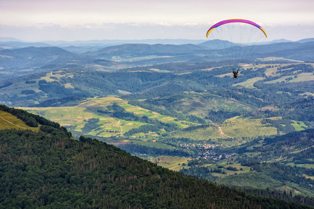 Skydiving  flying over the mountains. parachute extreme sport Stock Photo - 61105359