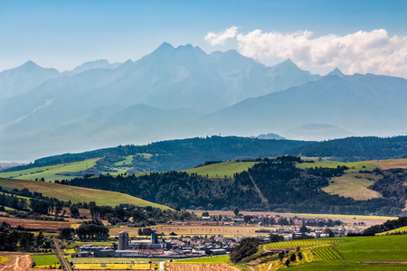 Rural landscape with fields and forest at the foot of Tatra mountains in Slovakia Stock Photo