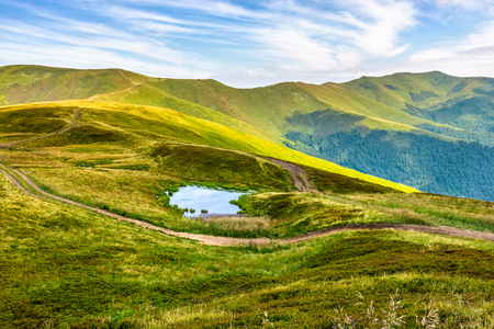 summer landscape in mountains with small swamp on hill side Stock Photo