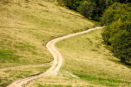 mountain landscape. travers path through hill side to the mountain top Stock Photo