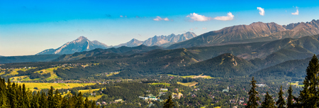 Summer panorama of High Tatra Mountain range near the village Zakopane in Poland Stock Photo