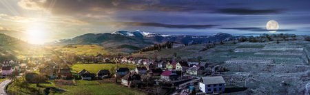 Day and night concept image of early spring rural landscape. Panorama of village near the fields on hill side at the foot of the  mountains with snowy peaks