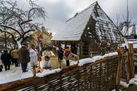 Uzhgorod, Ukraine - January 15, 2017: Carols in old village festival in TransCarpathian Regional Museum of Folk Architecture and Life Editorial