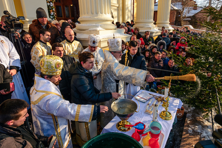 UZHGOROD, UKRAINE - January 19, 2017: Ceremony Greek-Catholic church during celebration of the Epiphany Day. Editorial