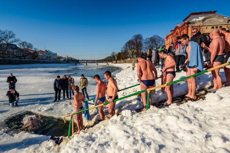 UZHGOROD, UKRAINE - January 19, 2017: Ice swimming in Greek-Catholic parishioner on Epiphany Day Editorial