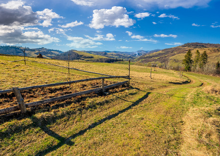 wooden fence on hillside in the rural area