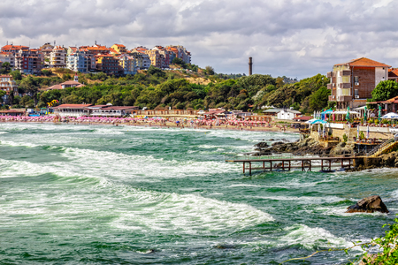 SOZOPOL - AUGUST 9: Old City  beach on August 9, 2015 in Sozopol, Bulgaria. Waves running  on to the beach of ancient Bulgarian city Sozopol in the mornig Editorial
