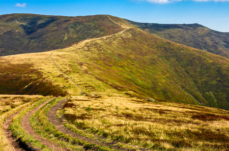 summer mountain landscape. winding road through the ridge to the top. late summer fine weather Stock Photo